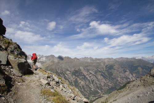 A hiker in the mountains of Walker's Haute Route