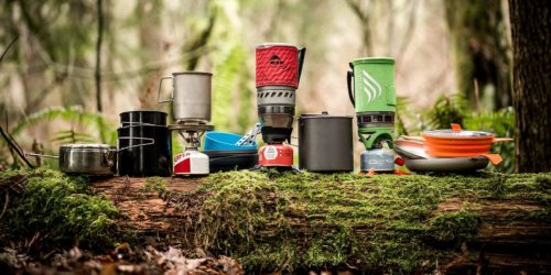Different portable stoves on a forest background