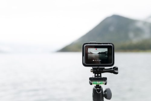 Camera equipment on a lake and mountain background
