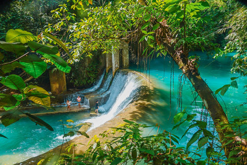 A picture of kids playing at Kawasan Falls, Philippines
