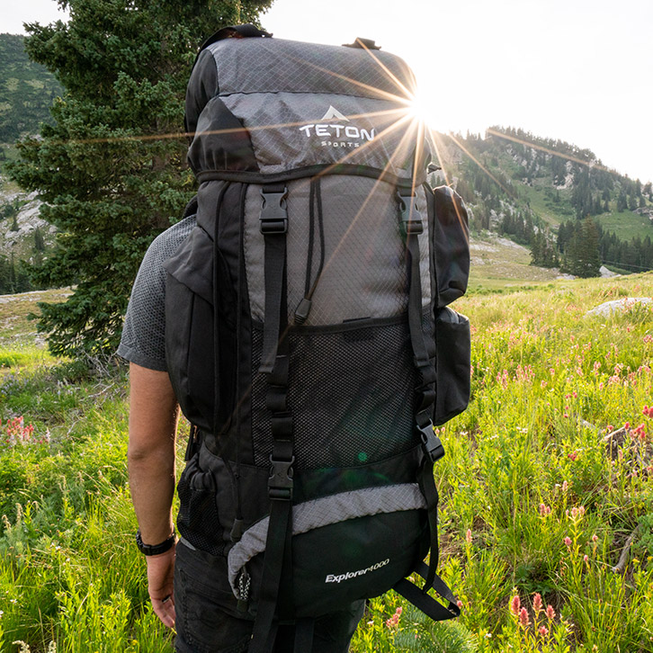 A man hiking with the Teton Sports Explorer 4000 backpack