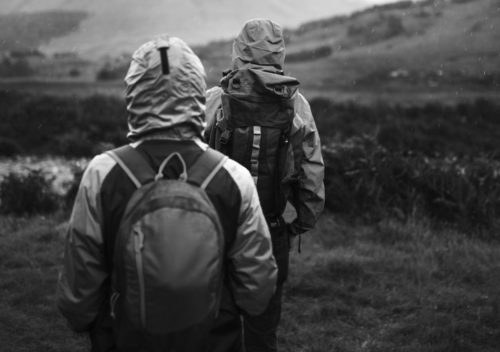 2 persons with backpacks hiking