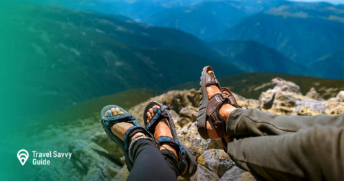 people in sandals on a mountain cliff