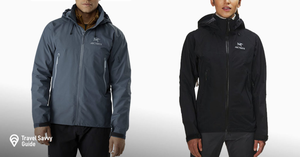 A man and a woman wearing Arcteryx Beta AR rain jacket