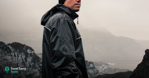 Man in black rain jacket on a rocky background