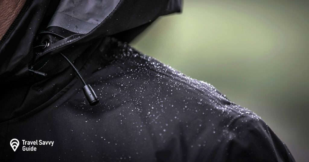 A black rain jacket showing its water repellant properties
