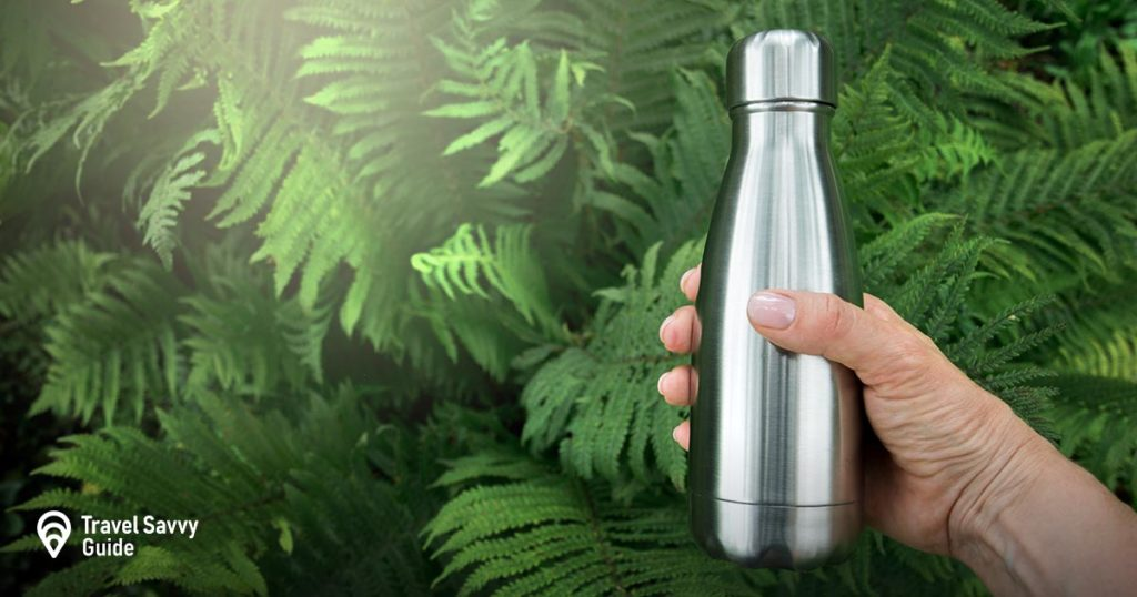 steel flask on a green background