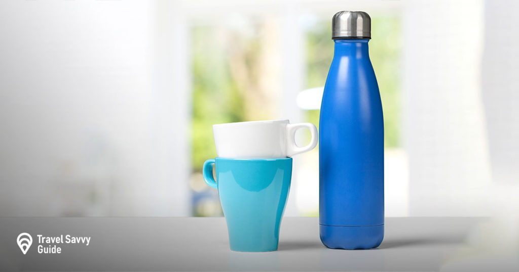 steel water bottle near 2 cups