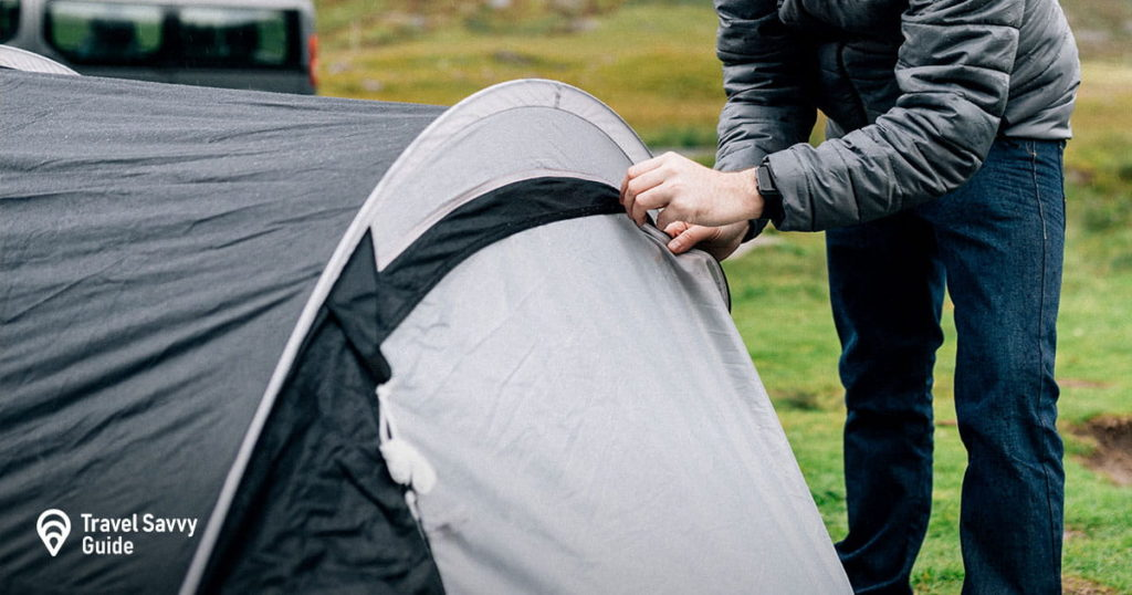 Man trying to unzip a tent