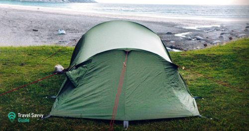 Green tent on a shore