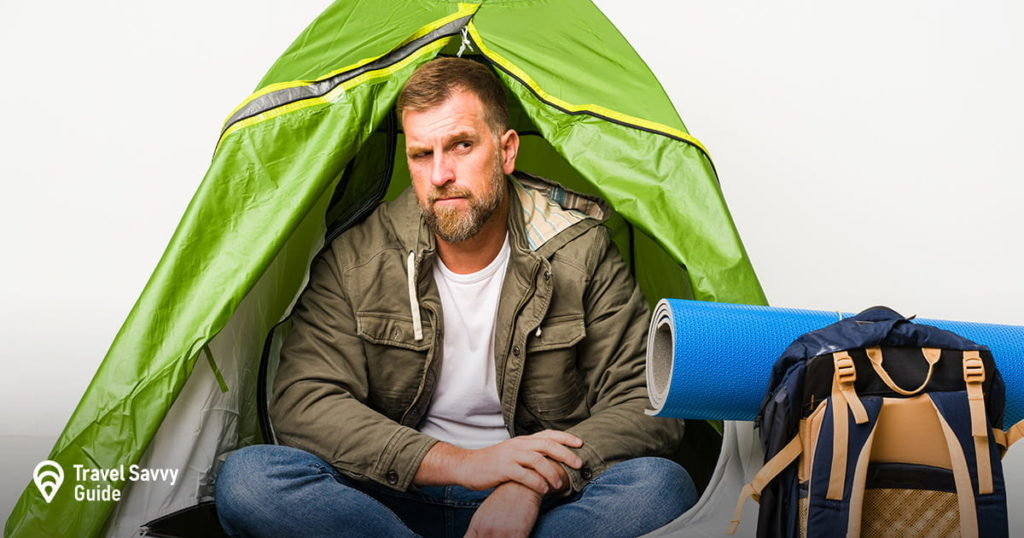 Senior inside a tent isolated on white confused, feels doubtful and unsure