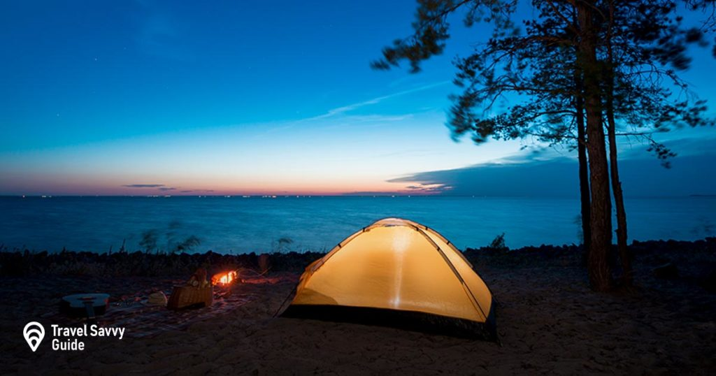 tent by the sea overlooking the sun fall