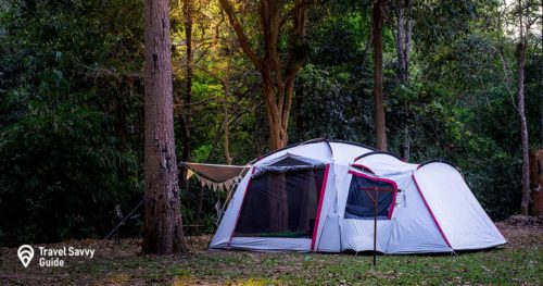 Camping and tent in nature park with sunset