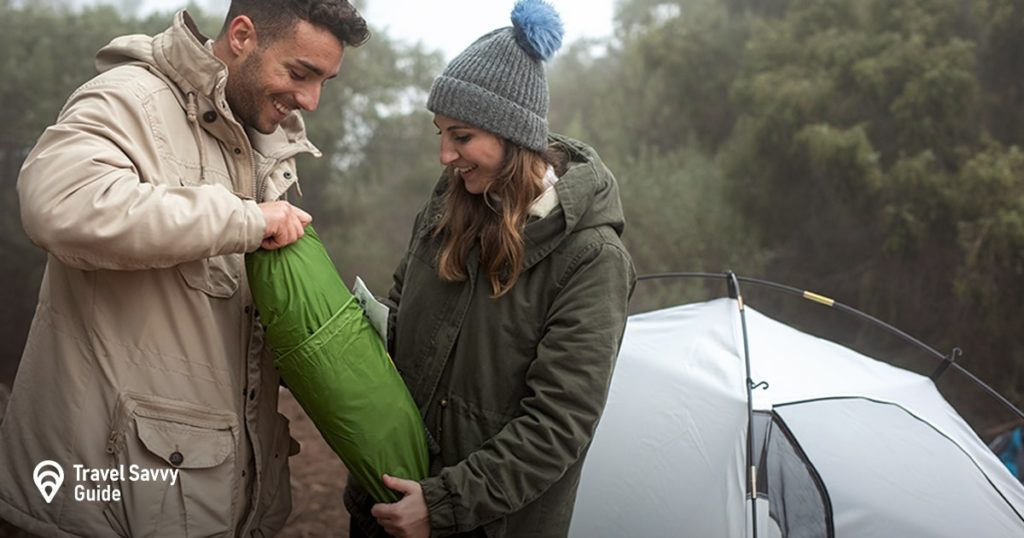 couple putting up a tent