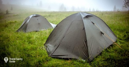 Tourist tent camping in the rain in mountains.