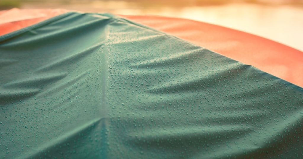 Drops of water on the tent, dew on the roof of a camping tent,fog