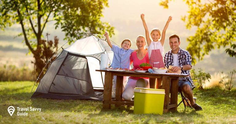happy family on camping at sunset