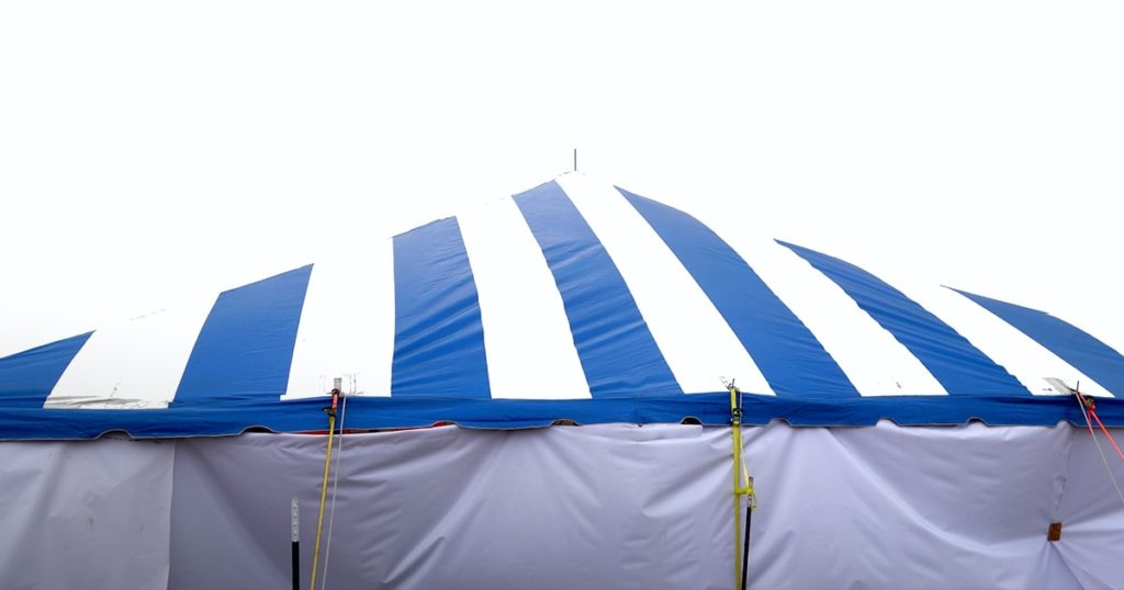 large white and blue stripe entertainment or events tent