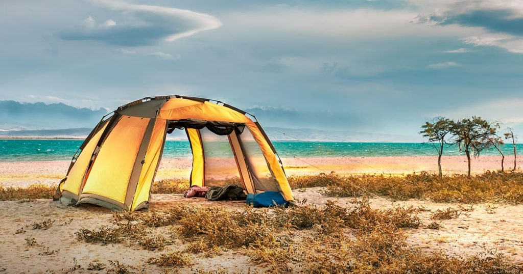 Tourist tent on the beach. Tent on the seashore