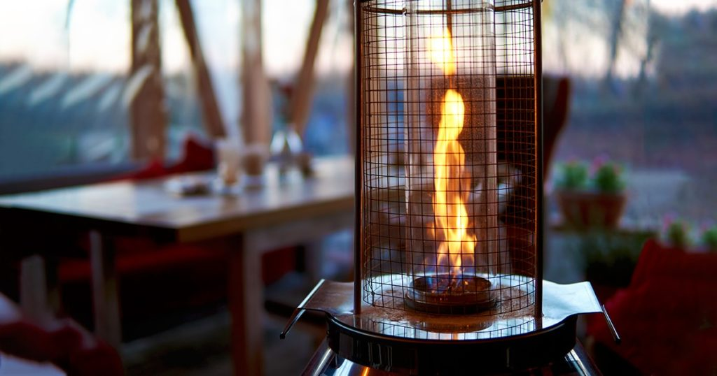 Gas flame heater typically used on outdoor