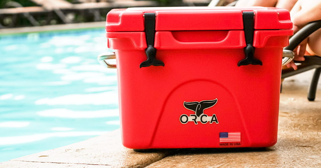 ORCA red cooler at pool