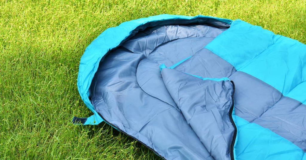 Sleeping bag unzip and closeup inner polyester