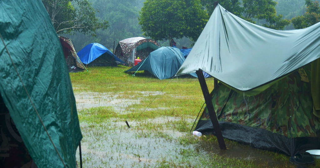 Camping activities in a rain-filled holiday