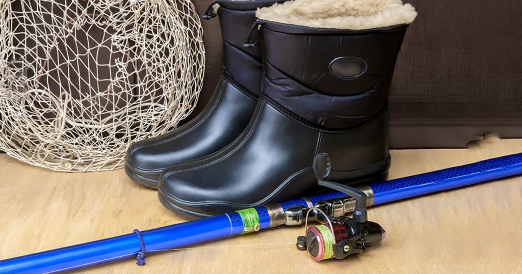 items for fishing: landing net, spinning and warm waterproof boots
