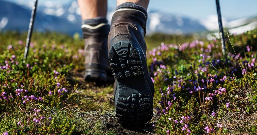 Hiking boots on landscape background