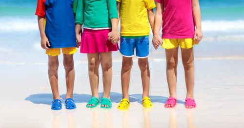 Group of children wearing aqua shoes