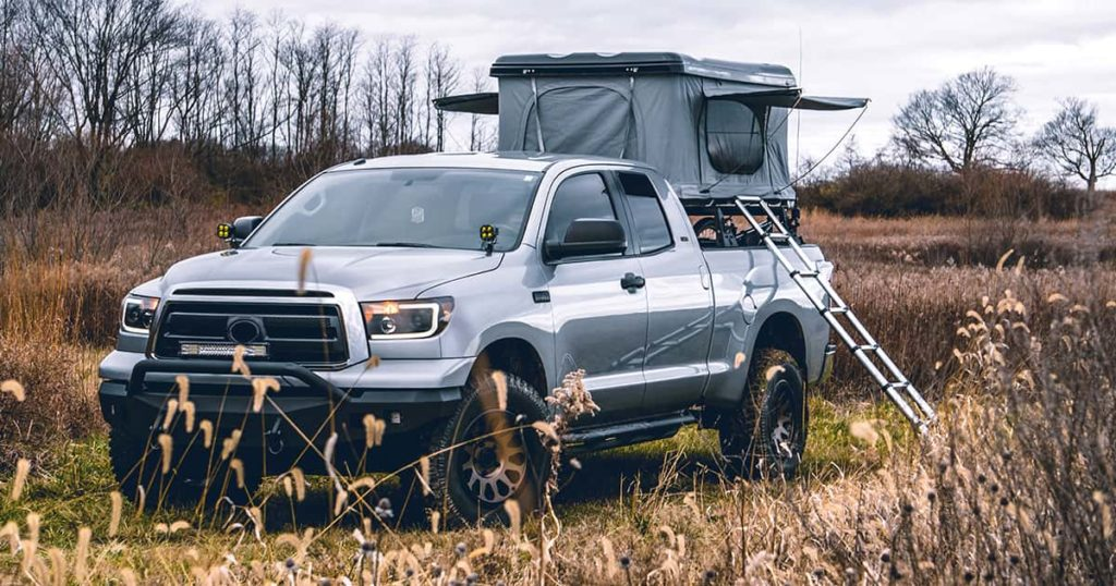 Truck with Roof Top Tent in Field