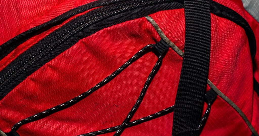 Red backpack with black zipper