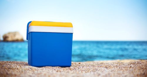 cooler box on sea sand