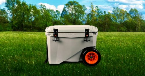 Ozark trail cooler with wheels on a green field