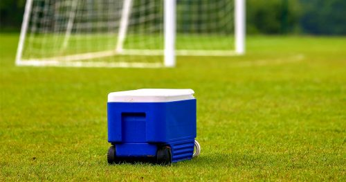 Wheeled Chest Ice Box Cooler blue in the middle of football field
