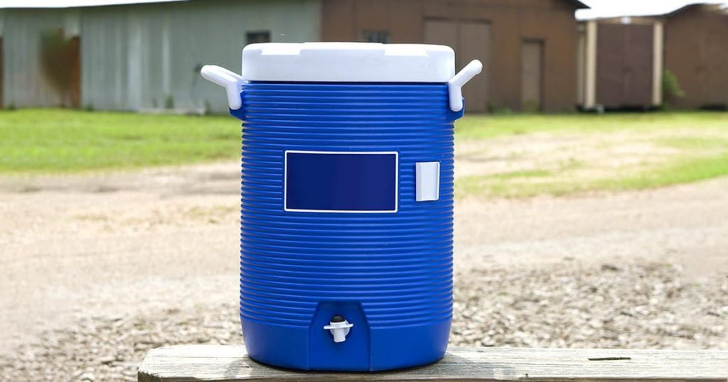 Blue water cooler on bench