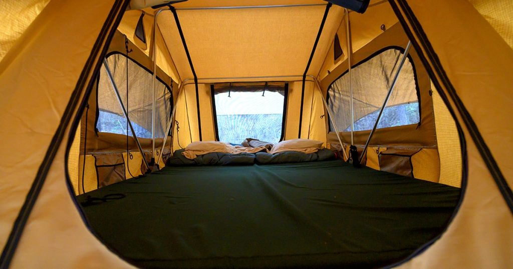 Rooftop tent interior wide angle view.