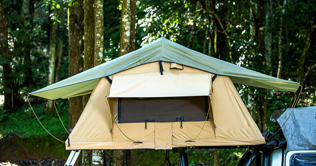 roof top tent on vehicle over forest view