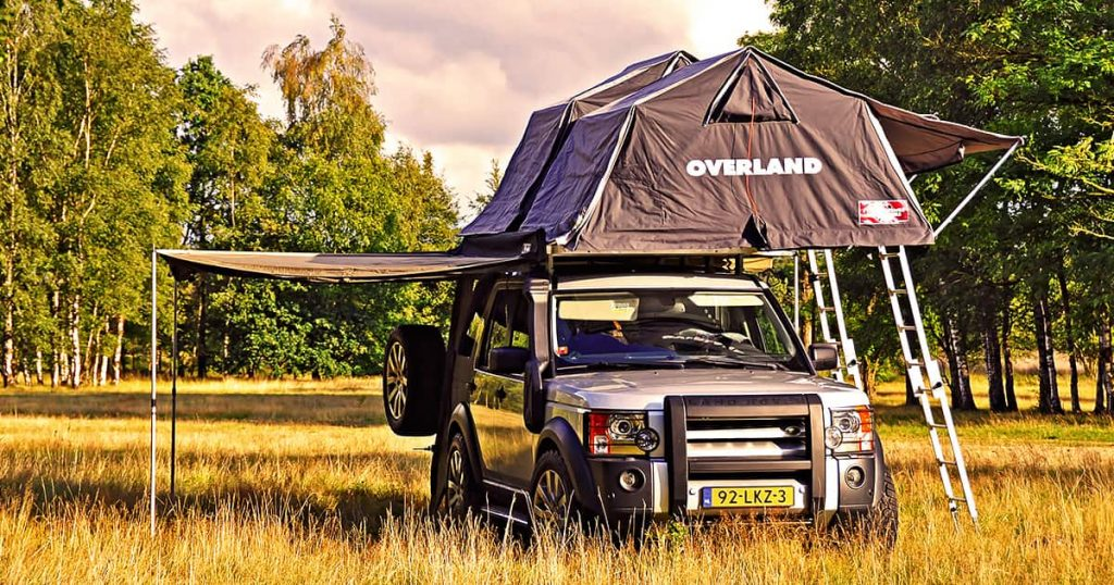 Off road vehicle camping in a forest with roof top tents