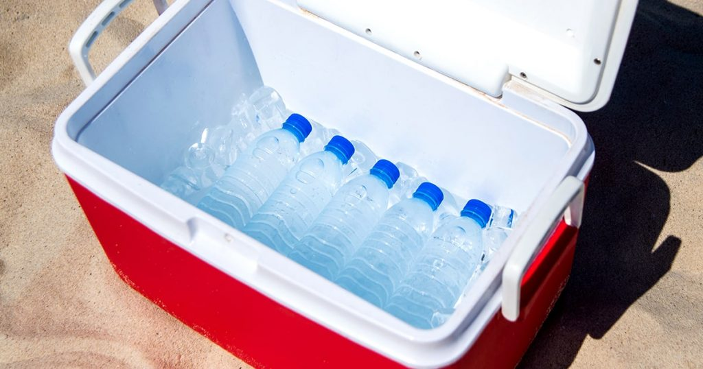 water bottles in a cooler with ice