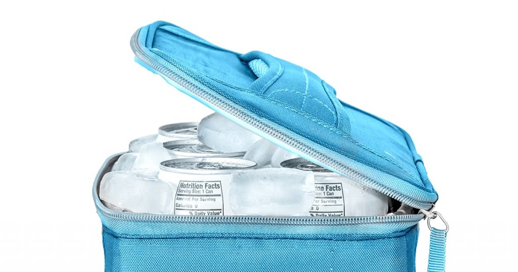 Blue soft side cooler bag filled with soda cans and ice cubes.