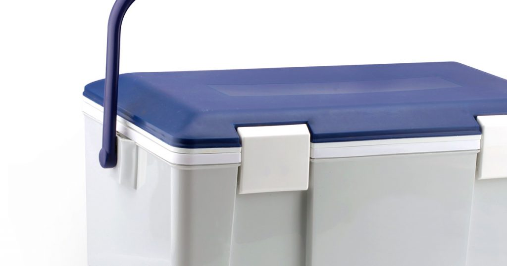 Handheld blue refrigerator isolated over white background. This has clipping path.