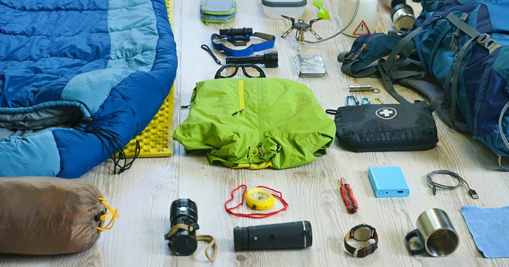 Things and accessories for trekking camping and travel, flat lay, top view set