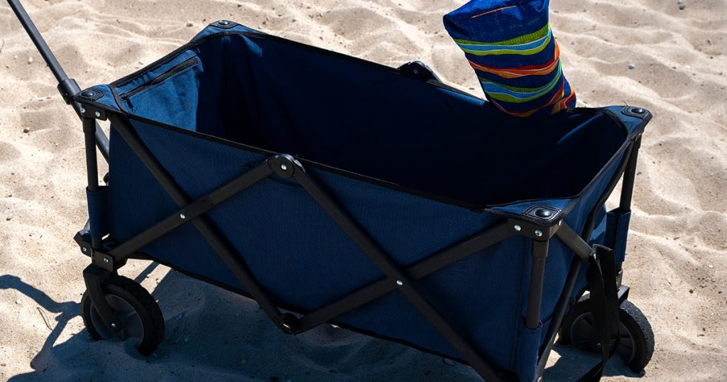 Blue empty beach cart with mat on the sand