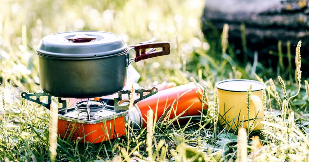 Cooking in a titanium cooking pot on a portable camp stove