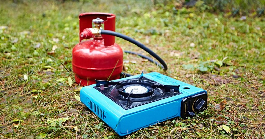 Portable tourist gas stove and a balloon with a hose