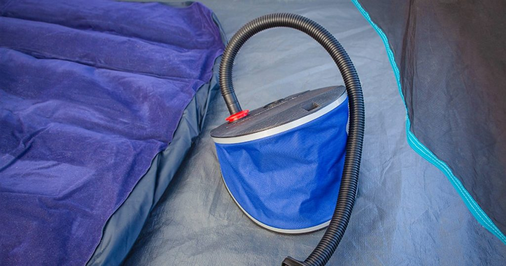 Pump for inflating a mattress in a tent outdoors.