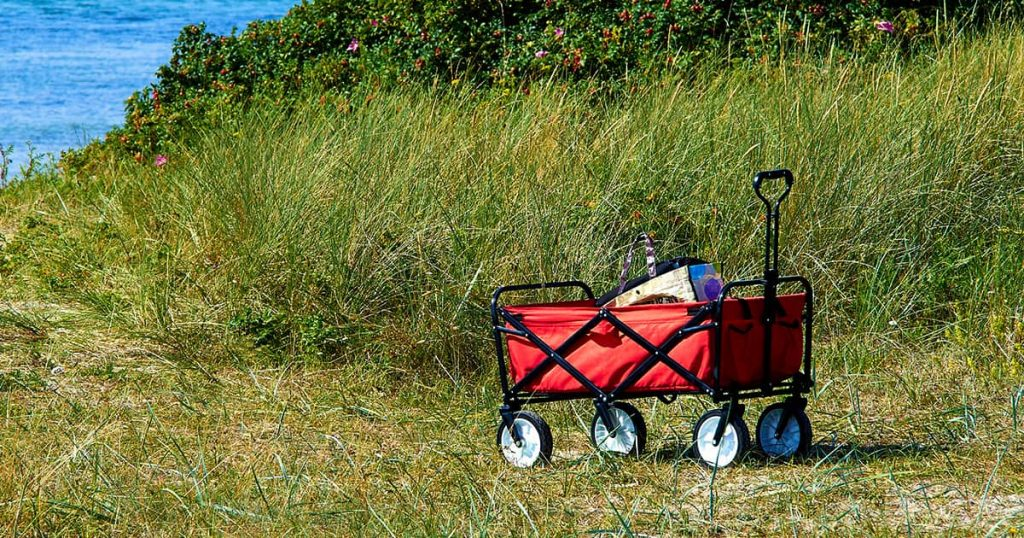 Red beach cart trolley by the sea shore for a great summer vacation outdoors fun