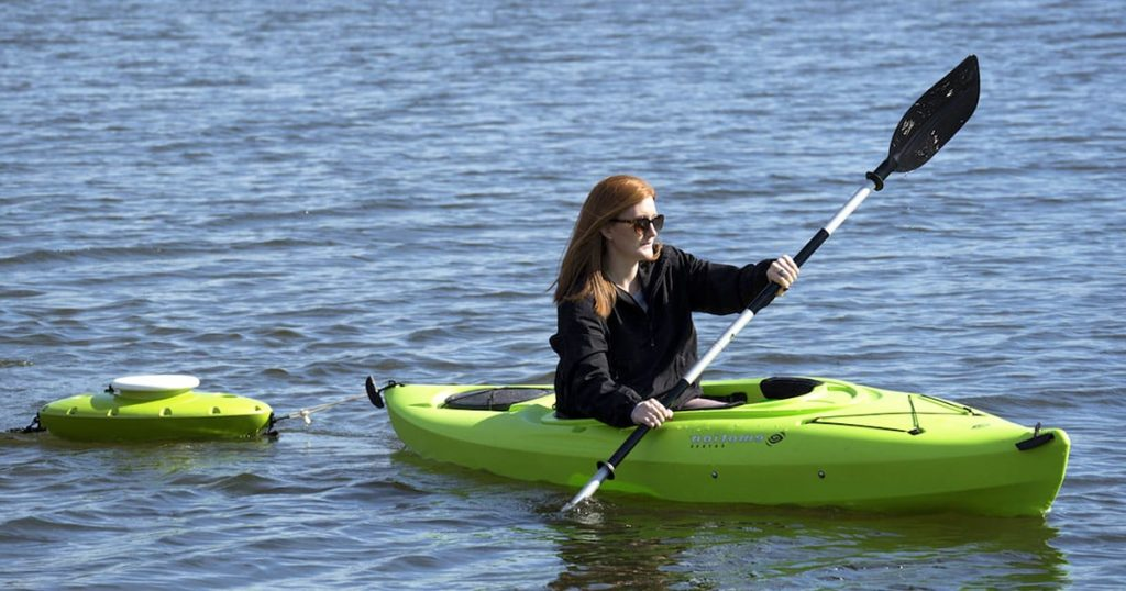 Woman kayaking with a Floating Cooler