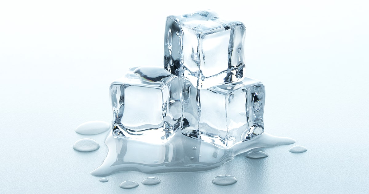 Melting Ice cubes with water drops on a table